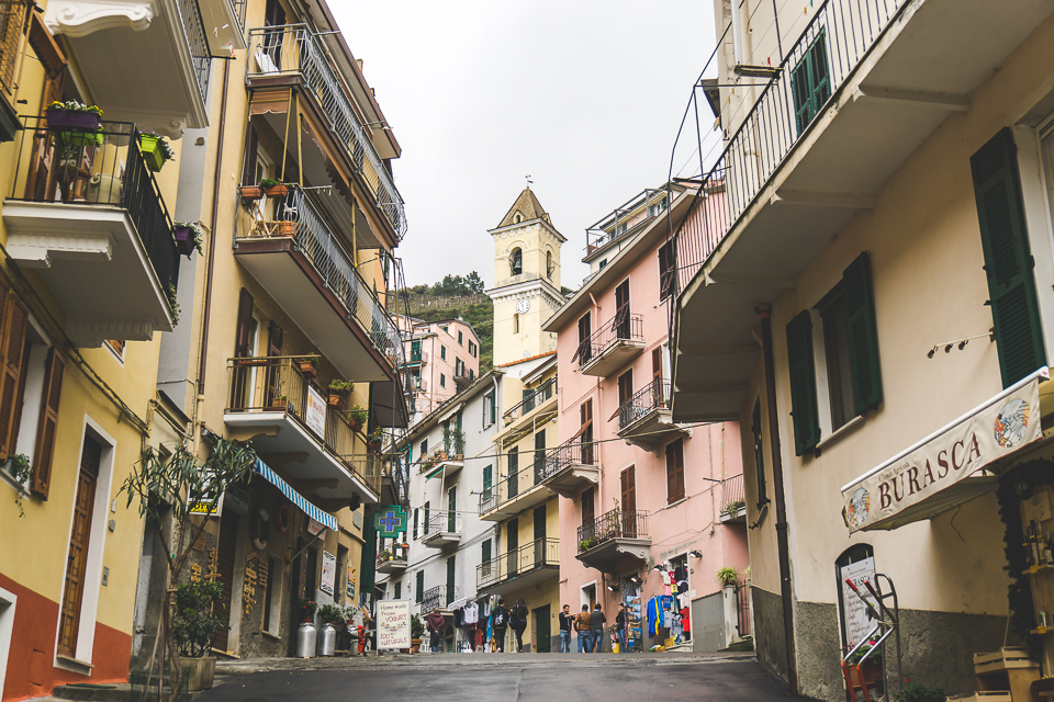 The main street in Manarola leading to church tower